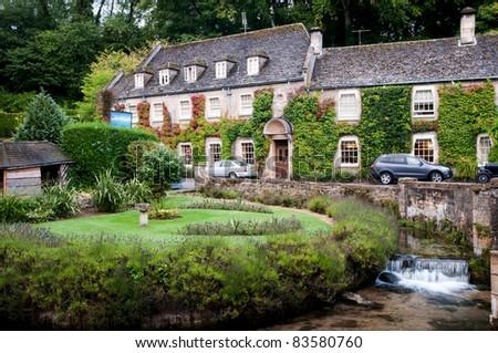 Country house hotel ,Bibury,England - stock photo