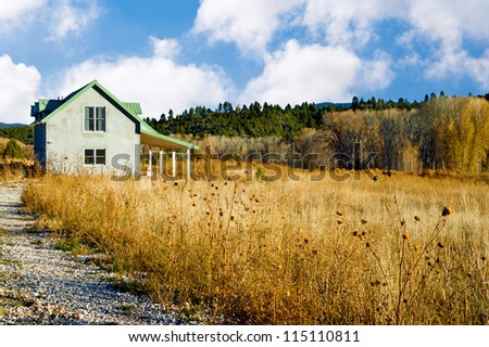 Country house in an autumn landscape in the American Southwest - stock photo