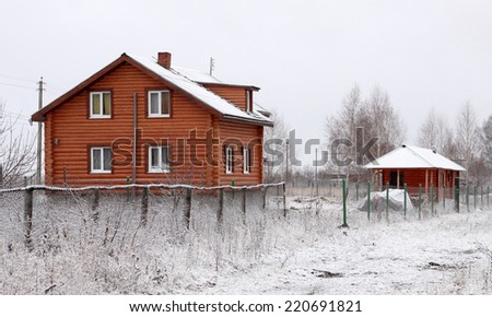 Country house with shed in the winter