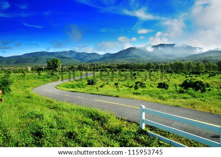 Country road  against blue sky background, Chiang mai , Thailand - stock photo