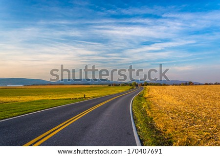 Country road and distant mountains in rural Frederick County, Maryland. - stock photo