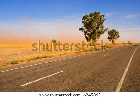 Country Road and Dust storm in outback Australia - stock photo