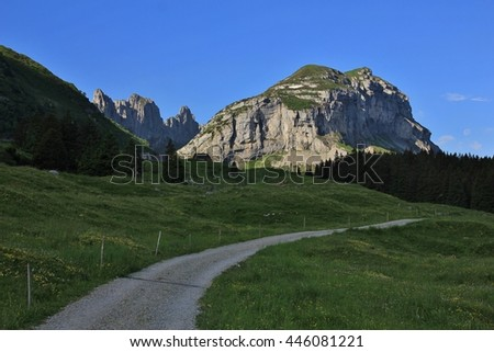 Country road and mountains of the Alpstein Range. Summer scene in Appenzell Canton, Switzerland. - stock photo
