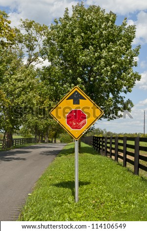 Country road and Stop sign ahead - stock photo