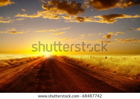 Country road and  sunset. - stock photo