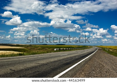 Country road at summer sunny day - stock photo