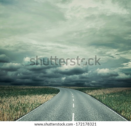 Country road before thunderstorm - stock photo