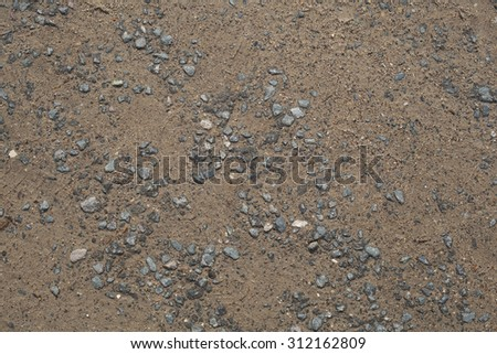 Country road. Gravel, pebbles and sand close up - stock photo