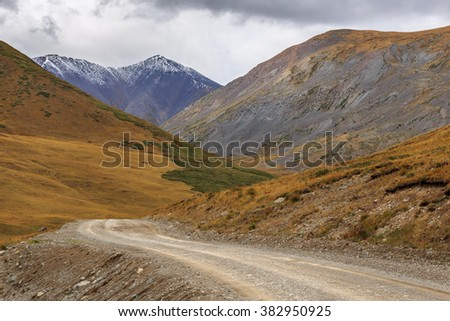 Country road in Altai mountains. Russia - stock photo