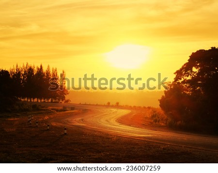 country road in evening - stock photo