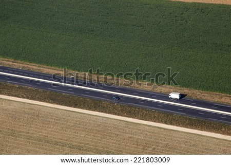 Country road in france farmland - stock photo