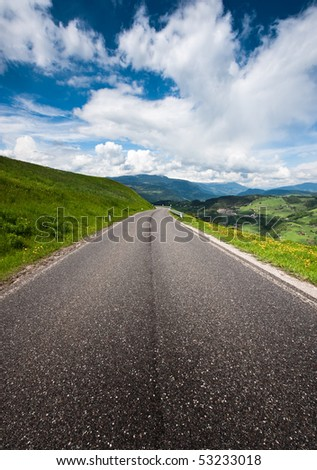 Country Road in the Alps - stock photo