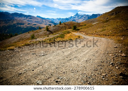 Country road in the mountains - stock photo