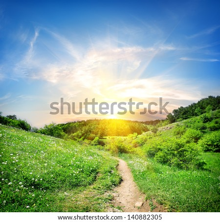 Country road in the mountains at sunset - stock photo