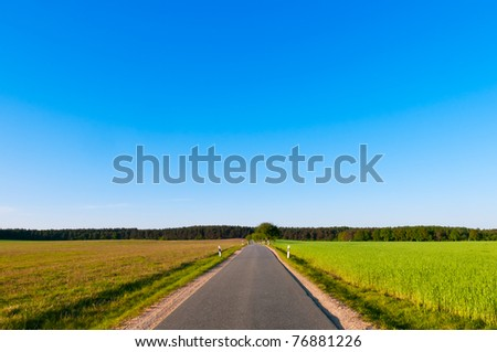 Country road in the south of Mecklenburg-Vorpommern, Germany. - stock photo