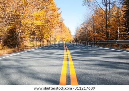 Country road in Vermont, USA. Autumn landscape - stock photo