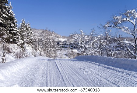 Country road in winter frosty day - stock photo