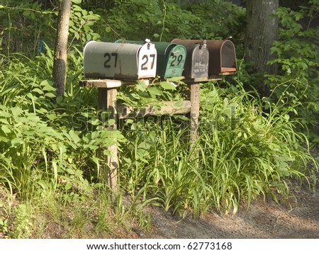 Country road mail boxes - stock photo