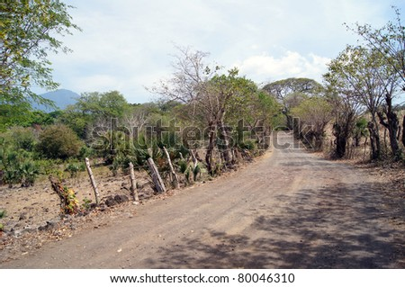 Country road on the island Ometepe, lake Nicaragua - stock photo