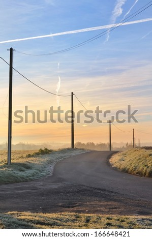 country road through the frost covered field