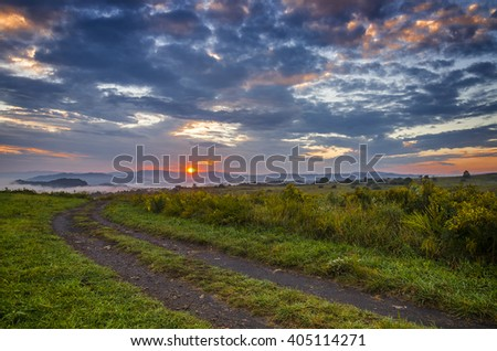 Country road trailing off into sunset in the Appalachian Mountains of Kentucky - stock photo