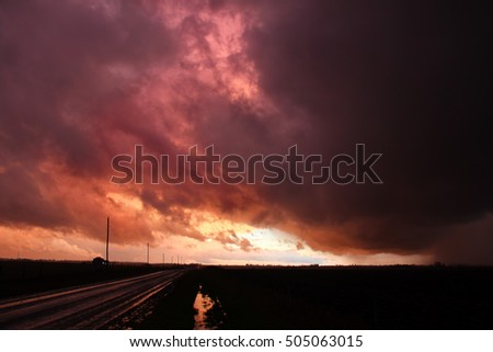 Country road under an evening thunderstorm in Rock Island County Illinois