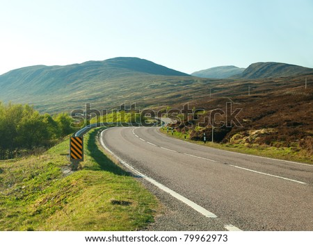 country road winding through the Scottish Highlands. UK.