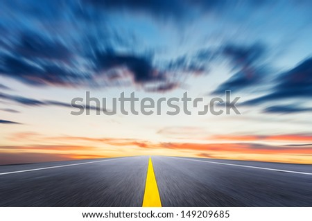 Country road with a dark sky - stock photo