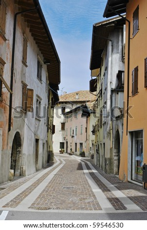 country road with old buildings typical of rural Italian - stock photo