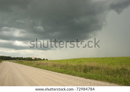 Country Road with Rainy Clouds