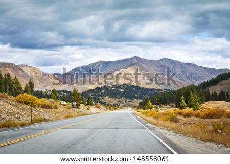 Country Road With Stormy Sky in Colorado - stock photo
