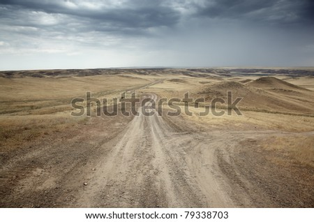 Country roads in the desert steppe - stock photo