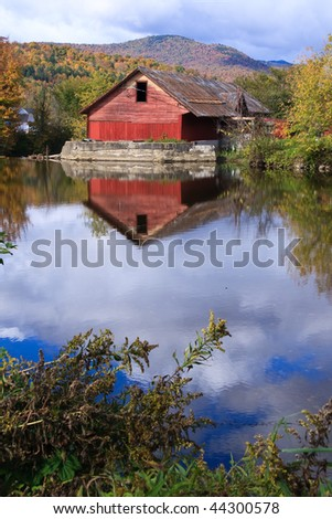Country Scene of Rustic Mill on River - stock photo