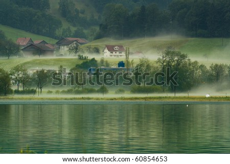 Country side view in Switzerland with fog - stock photo