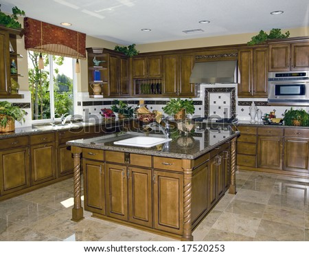Country style kitchen with granite counters and stainless steel appliances - stock photo