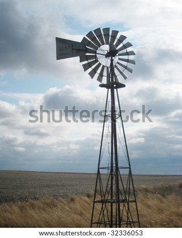 country windmill against a cloudy sky