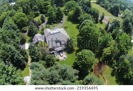 Countryside home and large yard in the Midwest aerial view - stock photo