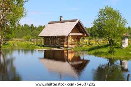 Countryside house at the lake - stock photo