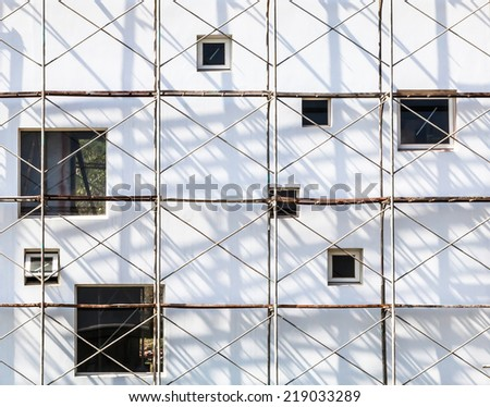Countryside house in scaffolding-2 - stock photo