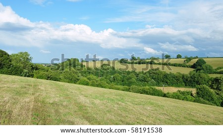 Countryside Landscape of the Cotswolds Hill Range in Southwest England - stock photo