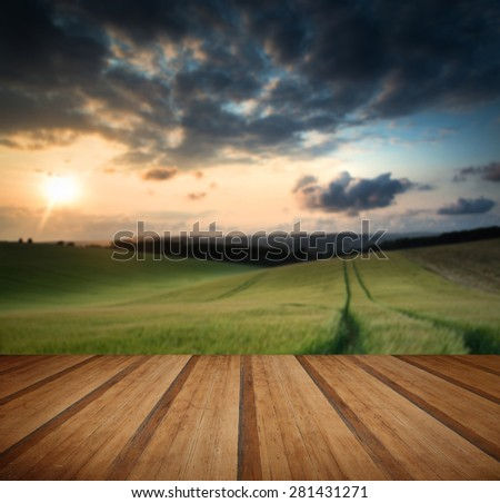 Countryside landscape Summer sunset with wooden planks floor - stock photo