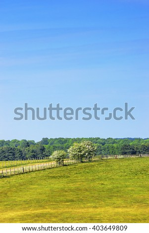 Countryside near Stonehenge in Wiltshire in UK. Wiltshire is a county in South West England. It is famous for many valleys and downhills. - stock photo