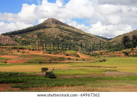 Countryside of Madagascar: beautiful countryside in central Madagascar with pastures, cultivated land and mountains. - stock photo