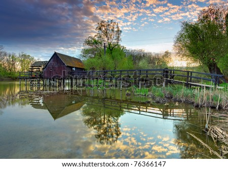 Countryside - river with watermill - stock photo
