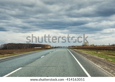 Countryside road at cloudy day - stock photo