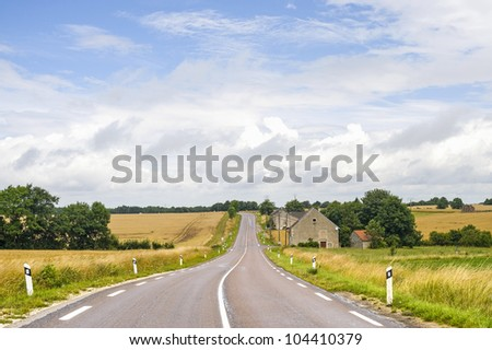 Countryside road in Cote-d'Or (Burgundy, France) at summer - stock photo