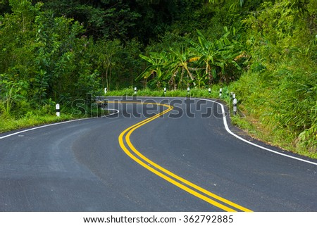 Countryside road in thailand - stock photo