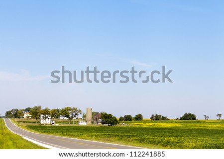 Countryside Road With Farm - stock photo