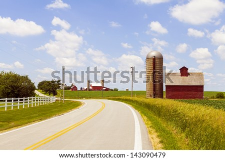 Countryside Road With Old Barn And Big Farm - stock photo