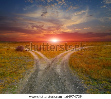 countryside roads on sunset background - stock photo
